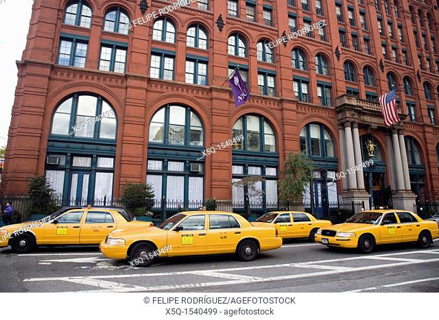 Yellow cabs before the Puck Building on Lafayette street, NYC, USA  Design by Albert and Herman Wagner