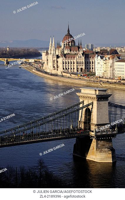Szechenyi Chain Bridge and the Hungarian Parliament Building. Hungary, Budapest, banks of Danube river