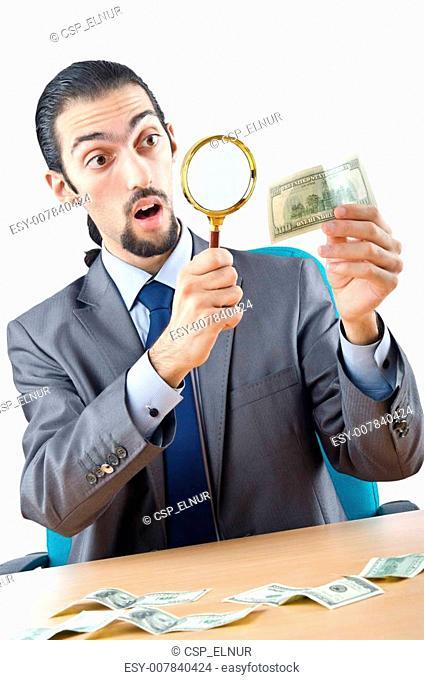 Detective detecting fake dollar banknotes