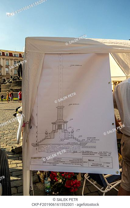 Members of the Association for the Marian Column Revival have stayed in their kiosk with a petition in support of the column in the square since Saturday in Old...