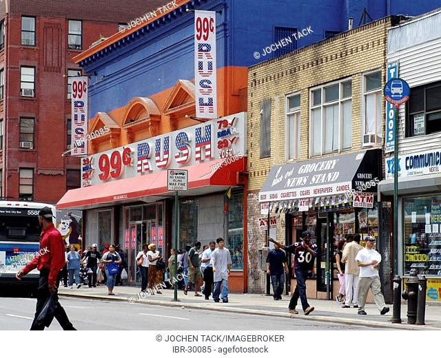 USA, United States of America, New York City: Harlem, 125th Street, shops with cheap goods, 99 cent bargains