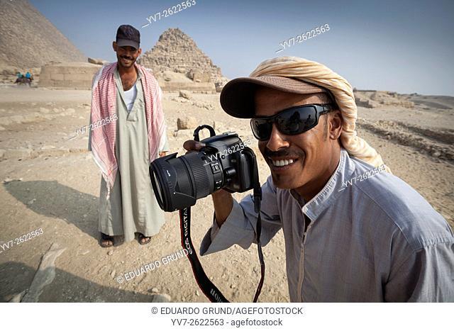 Camel drive. Pyramids of Giza, Pyramids of Giza, Cairo, Egypt