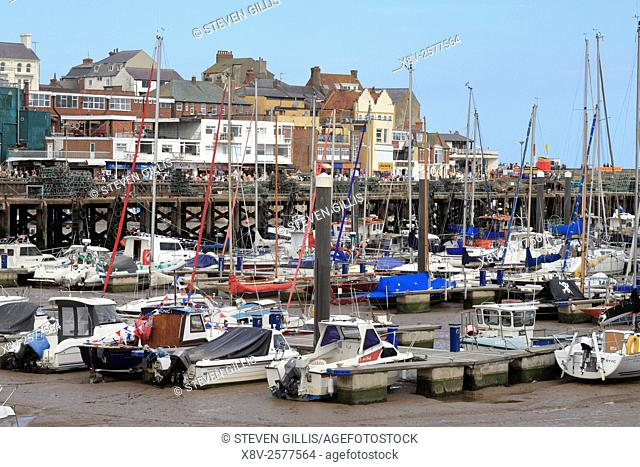 Boats in the harbour marina at low tide, Bridlington, East Yorkshire, England, UK