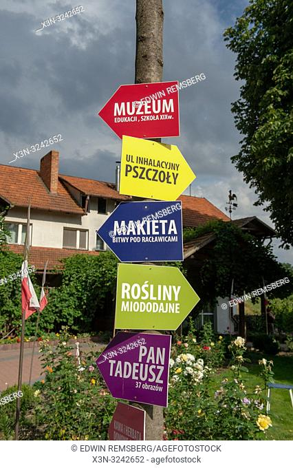 Directional signs of arrows in Polish language pointing in various directions on educational farm, Pszczólki, Pomeranian Voivodeship, Poland