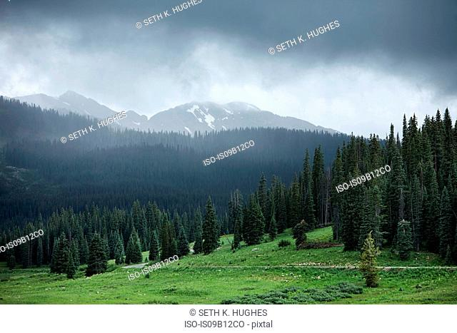 Storm clouds over mountain landscape, Crested Butte, Colorado, USA