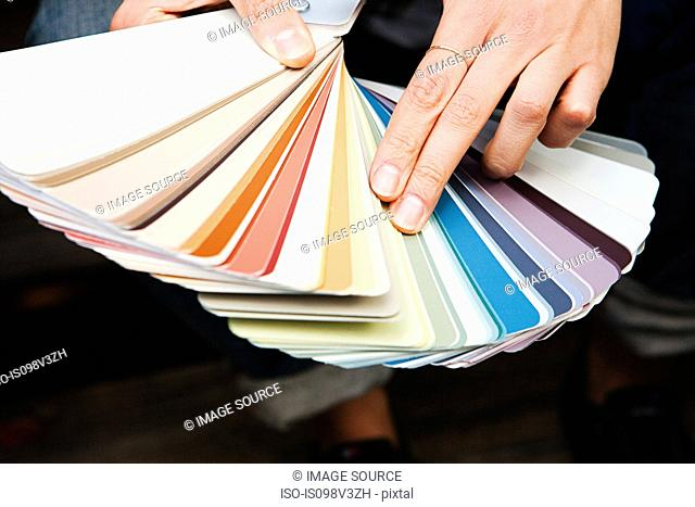 Woman looking at color swatch