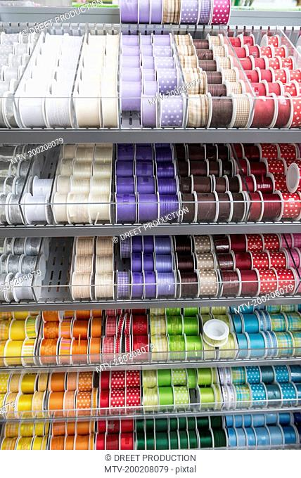 Multicolor ribbons for sale on store shelves, Augsburg, Bavaria, Germany