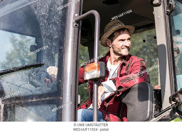 Smiling farmer on tractor