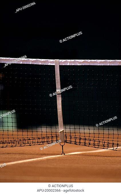 Net on a clay tennis court