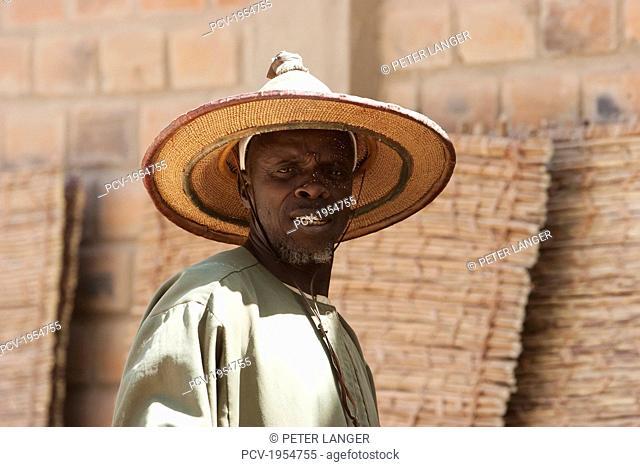 Man wearing a Fulani Straw Hat, Monday Market, Djenne, Mali