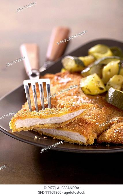 Scaloppine milanesi (breaded veal escalope with a side dish)