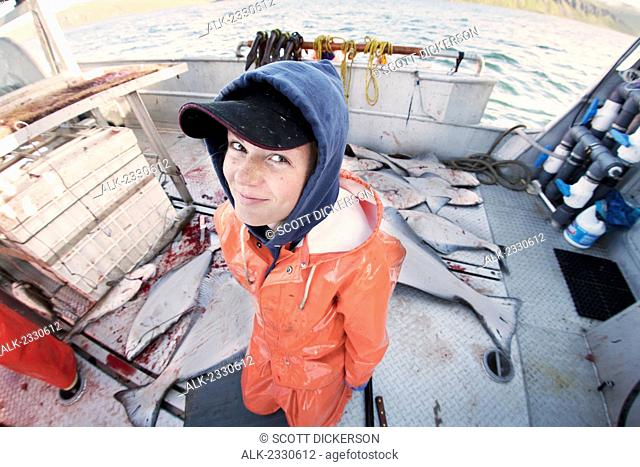 Portriat of Emma Laukitis in her raingear while commercial halibut fishing in Southwest Alaska, summer