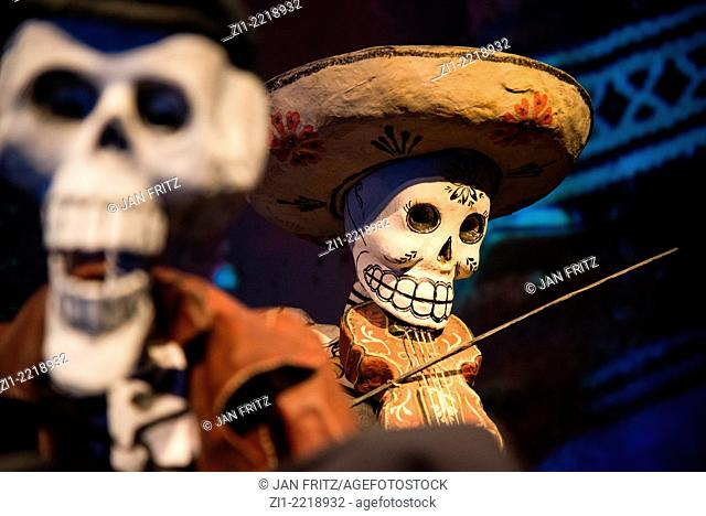 decorated paper mache skeleton musicians used by celebrating all saints day in Mexico