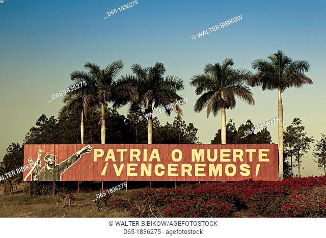 Cuba, Pinar del Rio Province, Pinar del Rio, roadside patriotic mural with Fidel Castro