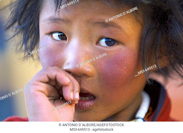 a tibetan boy. Ngari Prefecture. Tibet province. China. Asia