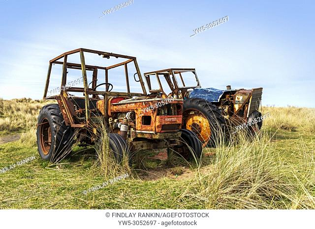 Two rusting tractors, one a Czechoslovakian Zetor 6718, built in 1972 in a field near Goswick, Northhumberland, England