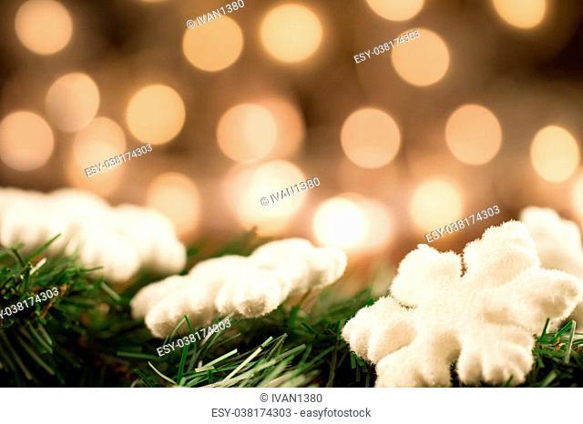 white Christmas snowflakes background defocused yellow lights. Festive decoration