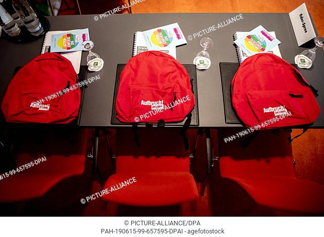 """15 June 2019, Brandenburg, Schönefeld: Backpacks with the inscription """"""""Aufbruch"""""""" are ready for the comrades at the state party conference of Die Linke..."""