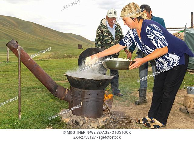 Kazakh nomads preparing pasta, Ile-Alatau National Park, Assy Plateau, Almaty, Kazakhstan, Central Asia, Editorial Use only