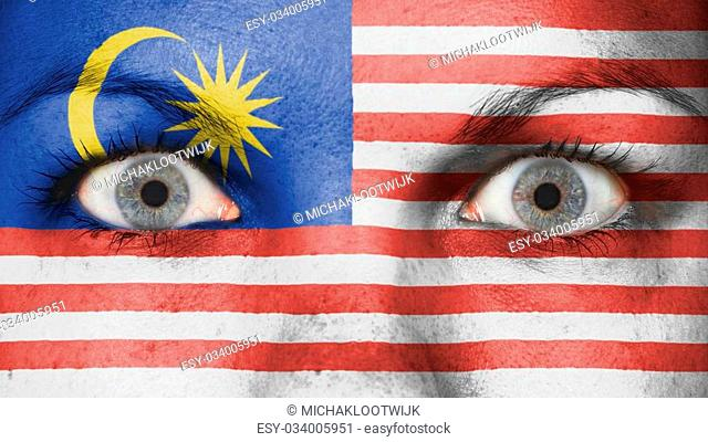 Close up of eyes. Painted face with flag of Malaysia
