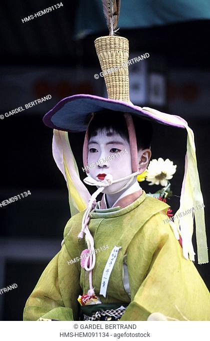 Japan, Honshu Island, Kyoto, dressed up child during Gion Matsuri Festival