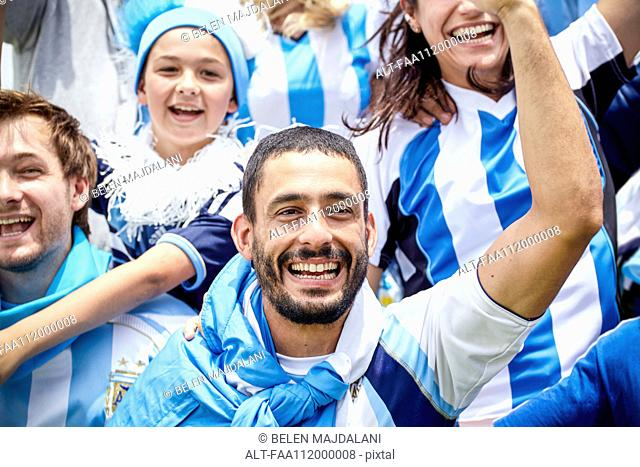 Argentinian football fans cheering at match