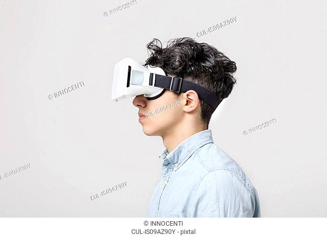 Young man wearing virtual reality headset