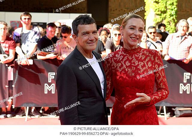29 June 2019, Bavaria, Munich: The Spanish actor Antonio Banderas and the director of the Munich Film Festival, Diana Iljine