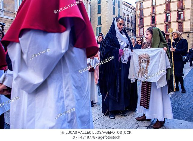 Penitents in procession, sisterhood of Virgen de las Angustias,Good Friday, Easter week,plaza Sant Jaume,Barcelona, Catalonia, Spain