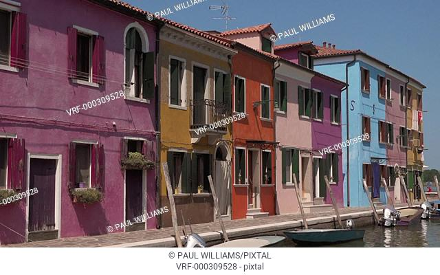 Zoom back on the traditional colourful houses of Burano Island, Venice Lagoon, Italy