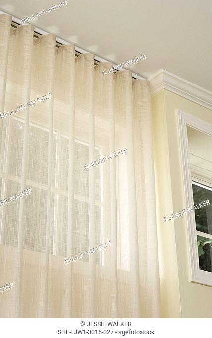 WINDOW TREATMENTS: hidden curtain rod, sheer curtains from the ceiling, pale yellow walls ithwhite painted trim