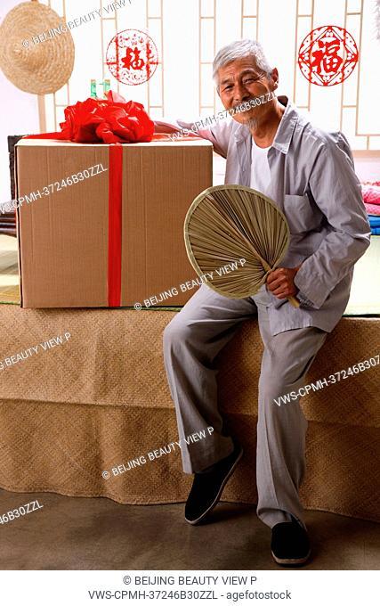 Elderly farmer with a large box