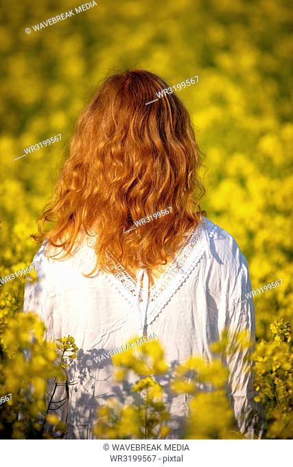 Woman standing in the mustard field