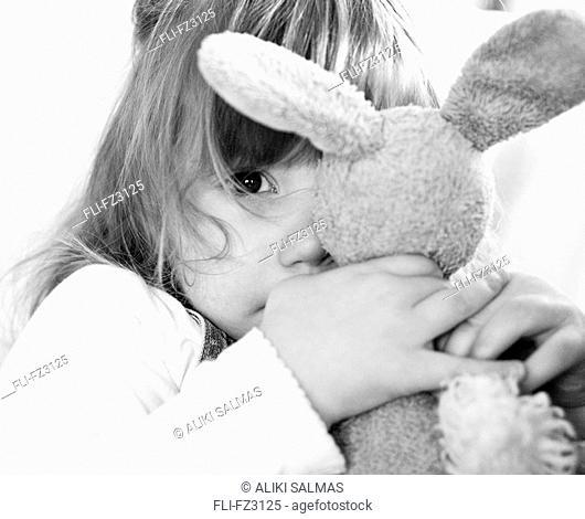 Girl clutching stuffed animal, Seattle, Washington