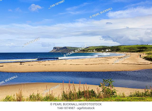 Ballycastle, Co Antrim, Northern Ireland, UK, Europe  View across the sandy beach to Fair Head or Benmore headland on the northeast coast