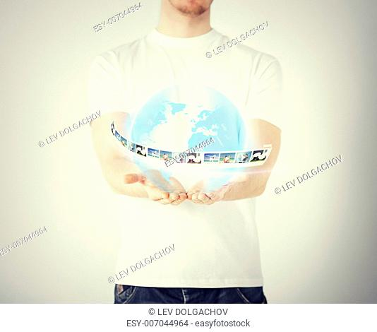 technology, internet, network and news concept - man hands with virtual globe and news