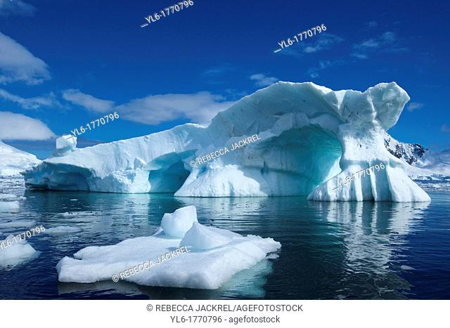 An iceberg reminiscent of Peter Pan's Skull Rock floats in Skontorp Cove on the Antarctic Penninsula