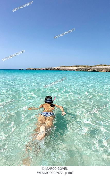 Spain, Menorca, Talaier Beach, girl snorkeling