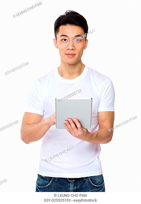 Asian man use of the digital tablt pc