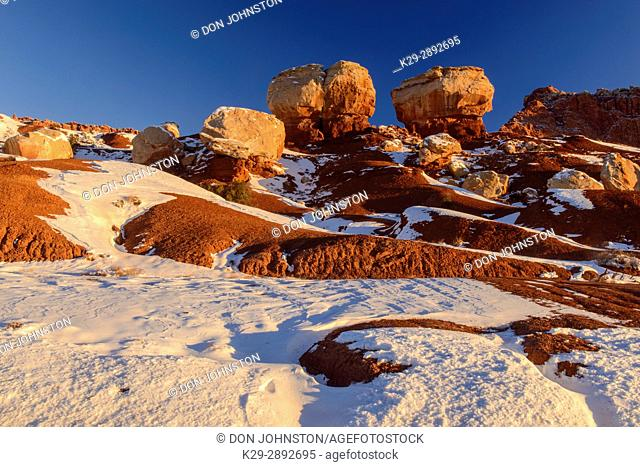 Recent snow in the high desert featuring Twin Rocks, Capitol Reef National Park, Utah, USA