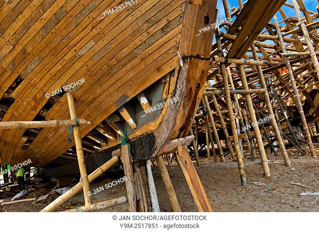 A wooden keel is seen during the construction process of a traditional fishing vessel in an artisanal shipyard on the beach in Manta, Ecuador, 14 September 2012
