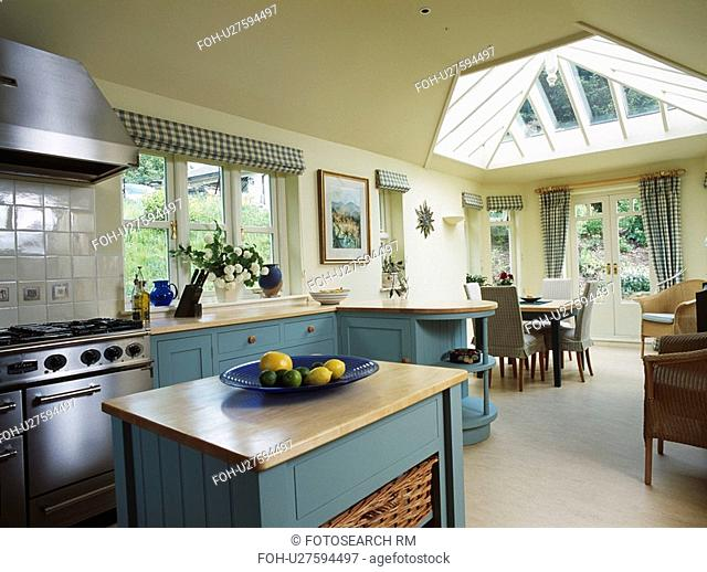 Wooden Worktop On Island Unit In Cream Kitchen Dining Room Extension With Turquoise Cupboards And
