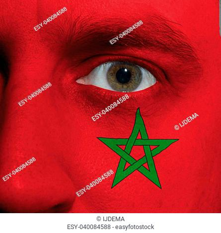 close-up of a face with the Moroccan flag painted on it