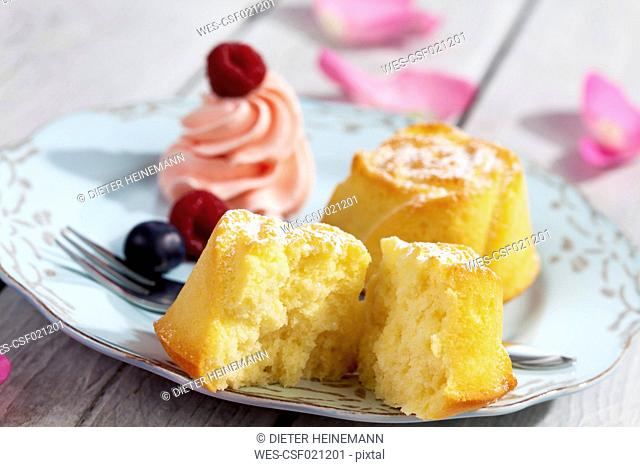 Muffin, berries and creme on plate