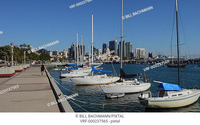 City of San Diego skyline with boats at Harbor Island in California with skyline of city in background