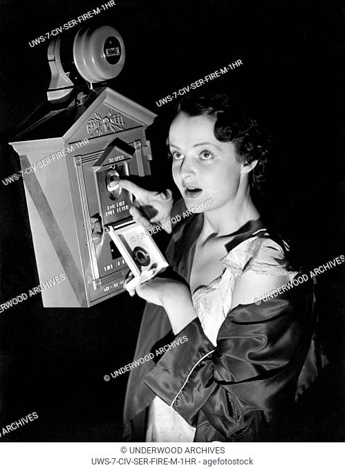 New York, New York: September, 1935 .A young woman demonstrates the new Gamewell Arrestolarm unit for reducing false fire alarms