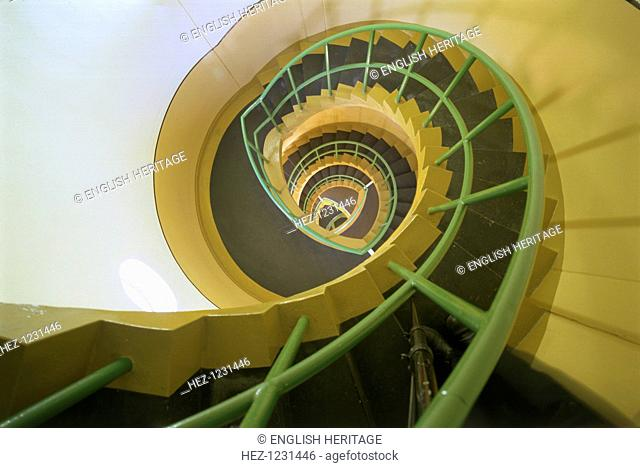 Staircase inside Dungeness lighthouse, Shepway, Kent, 1997. This is a view down the well of the spiral staircase inside the lighthouse