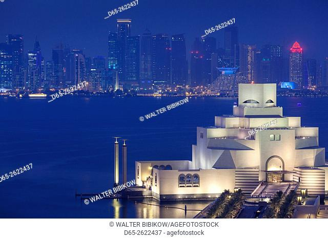 Qatar, Doha, The Museum of Islamic Art, designed by I. M. Pei, elevated view, dusk