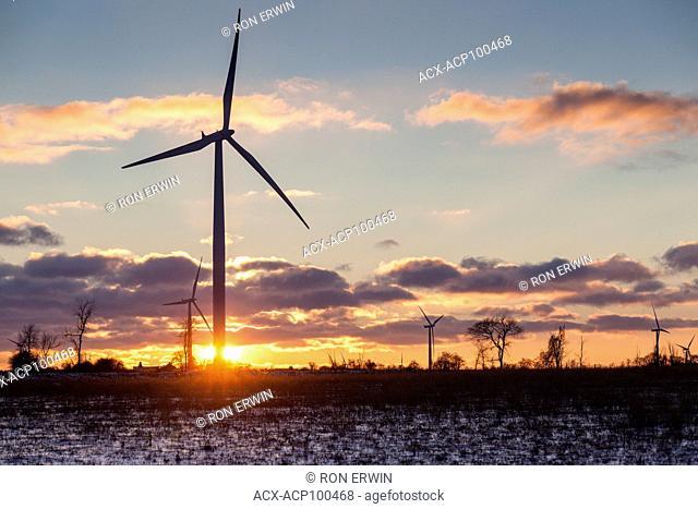 The sun setting behind wind turbines on Wolfe Island, Ontario, Canada