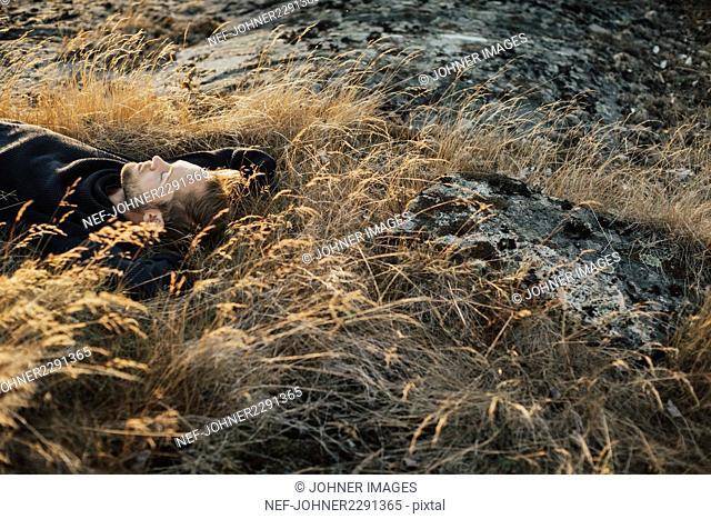 Man lying on meadow